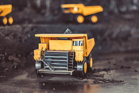 toy truck in the scenery of coal mining at the exhibition Imagens - 124705803