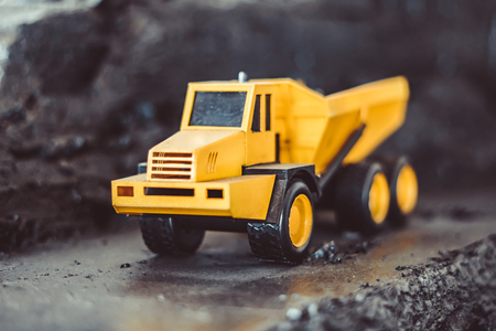 toy truck in the scenery of coal mining at the exhibition Imagens - 124705855
