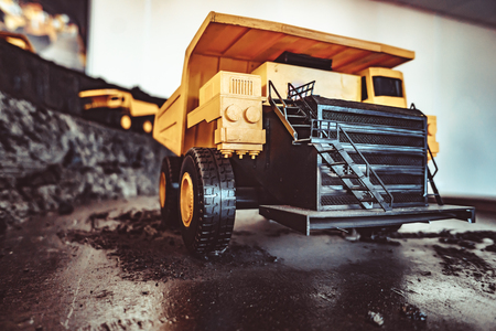 toy truck in the scenery of coal mining at the exhibition