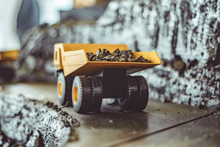 toy truck in the scenery of coal mining at the exhibition Imagens - 124705932