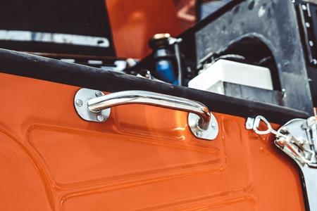 The red door handle of a truck Stockfoto