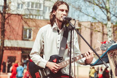 Russia, Siberia, Novokuznetsk - may 9, 2019: musicians sing songs on the street on victory day
