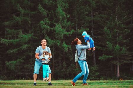 young family with children playing near the forest Standard-Bild