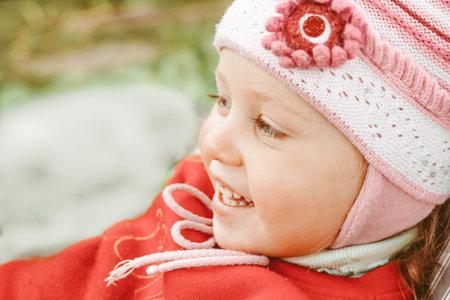 happy little girl in a beanie