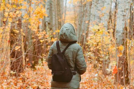 an elderly woman in the autumn forest Standard-Bild