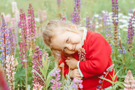 a child plays among the grass