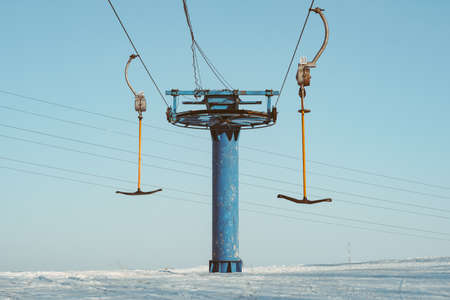 ski lift on snow mountain