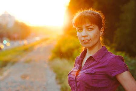 portrait of a beautiful girl at sunset Standard-Bild
