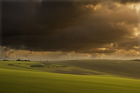 Stunning sunrise over agricultural landscape in England with ramatic stormy sky photo