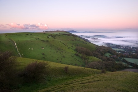 weald: View West across The Weald from Devils Dyke at sunrise across rolling English landscape Stock Photo