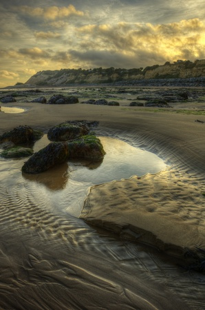 Beautiful summer sunrise over empty beach
