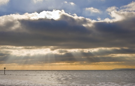 godlike: Beautiful inspirational sunset scene with sun beams over smooth sea Stock Photo