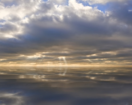 Stunning inspirational sunset image with glowing sun beams reflected in smooth simulated water photo