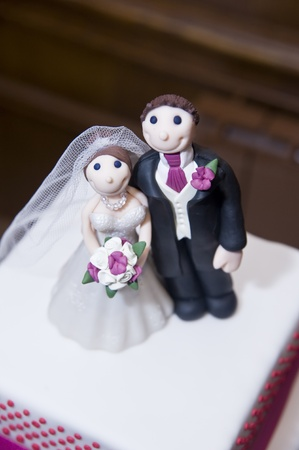 Bride and groom wedding cake ornaments detail photo