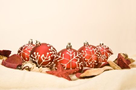 Christmas baubles and decorations on plain background photo
