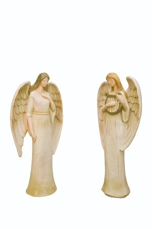 Two handmade wooden Christmas Angels isolated on white photo