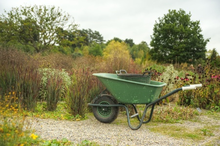 Peaceful scene with garden wheelbarrow in English country garden setting photo