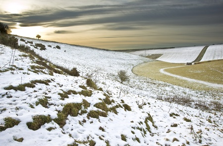 Winter snow landscape over fields with glowing sunset Stock Photo - 8560364
