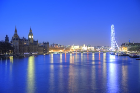 Beautiful night skyline of London from Parliament and Big Ben to London Eye taking in Westminster Bridge and River Thames