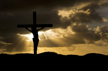 sacrifices: Silhouette of Jesus Christ crucifixion on cross on Good Friday Easter Stock Photo