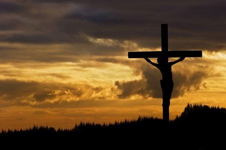 Silhouette of Jesus Christ crucifixion on cross on Good Friday Easter Stock Photo
