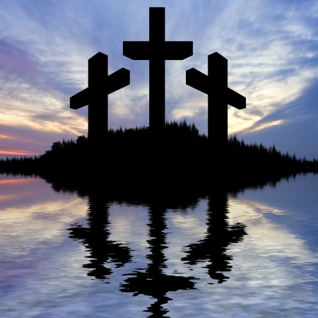 Silhouette of Jesus Christ crucifixion on cross on Good Friday Easter reflected in lake water photo