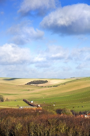 countrylife: Stunning views across countryside landscape of rolling hills and valleys with sunlight playing across peaks and troughs