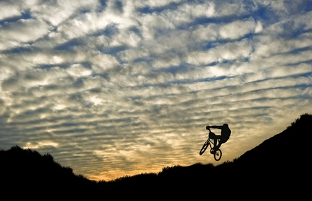 Extreme sports bike trials silhouette against beautiful sunset photo