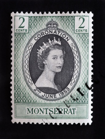 queen elizabeth: MONTSERRAT - CIRCA 1953 - First day cover postage stamp marking the coronation of Queen Elizabeth 2nd in England