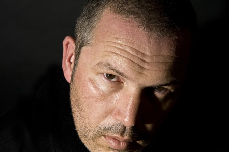 Dark and moody portrait of serious looking male adult Stock Photo - 8795266