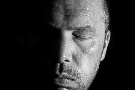 Dark and moody portrait of serious looking male adult Stock Photo - 8795281