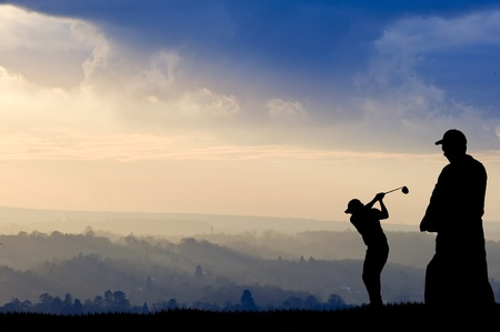 golf equipment: Silhouette of man playing golf on beautiful colorful sunset Stock Photo