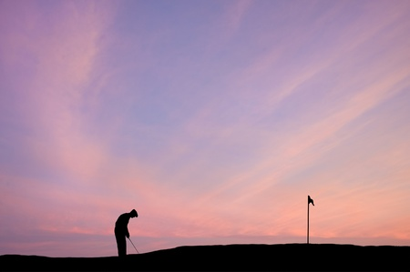caddie: Silhouette of man playing golf on beautiful colorful sunset Stock Photo