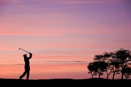 caddie: Golfer silhouette on beautiful colorful sunset evening sky