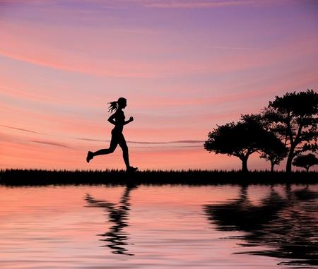 woman running: Woman jogger silhouette against beautiful sunset sky running through fields