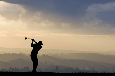 golfcourse: Silhouette of man playing golf on beautiful colorful sunset Stock Photo