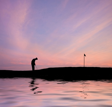 Silhouette of man playing golf on beautiful colorful sunset Stock Photo