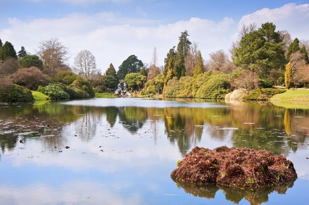 Lovely natural ornamental gardens in Spring with lake and waterfall photo