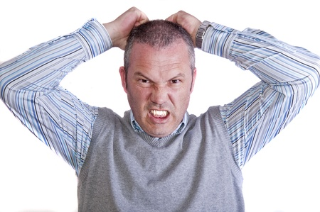 Portrait of frustrated angry mad stressed middle aged caucasian male