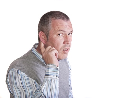 50 yrs: Middle aged caucasian male holds his ear to listen better to what you are saying Stock Photo