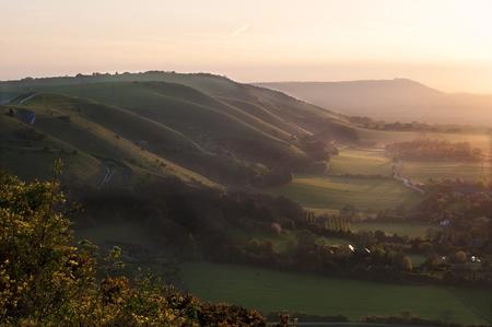Beautiful English countryside landscape during Spring sunset photo