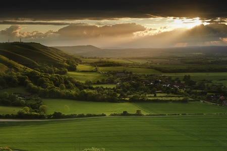 Landscape over English countryside landscape in Summer sunset photo