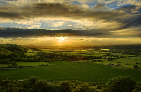 Beautiful landscape across countryside with sun beams lighting hills Stock Photo - 9603485