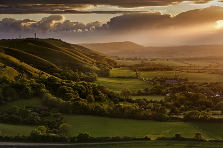 Beautiful landscape across countryside with sun beams lighting hills Stock Photo - 9603525