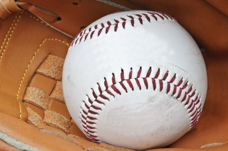 Macro shot of baseball in glove with shallow depth of field for attention on ball Stock Photo - 9603489