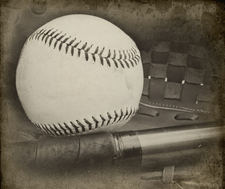 Image of baseball and catchers glove in vintage retro grunge stlye with added aged effects to give feel of nostalgia photo