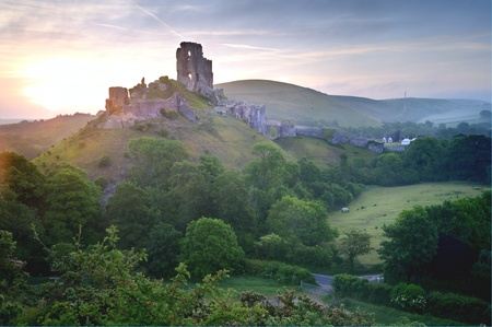 Beautiful dreamy fairytale castle ruins against romantic colorful sunrise Stock Photo - 9783528