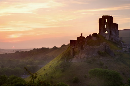 Beautiful dreamy fairytale castle ruins against romantic colorful sunrise Stock Photo - 9783621