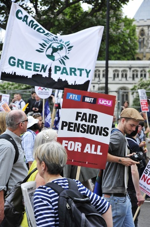 oap: LONDON - JUNE 30; Unidentified members of trade unions hold placards in protest against government spending cuts during a protest organised by PCS and NUT unions in London on June 30, 2011 Editorial