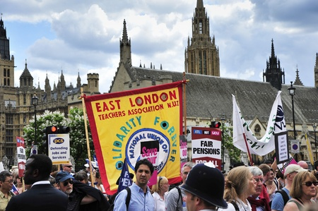 organised: LONDON - JUNE 30; Unidentified members of trade unions outside parliament protesting against government cuts during a demonstration  organised by PCS and NUT trade unions in London on June 30, 2011